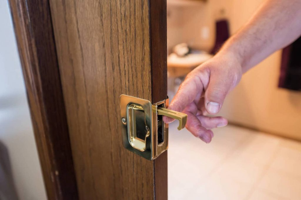 The pull for the pocket door recesses into the door and can be difficult to grasp for people with limited hand function. Also, if you need the door to lock, this is not the best option.