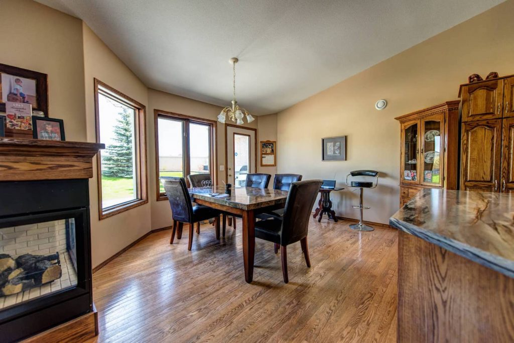 The dining room table is long, open underneath, and situated so that it is easily accessible from 3 sides.     Dining room windows are low and wrapped around to allow for full view of the backyard.