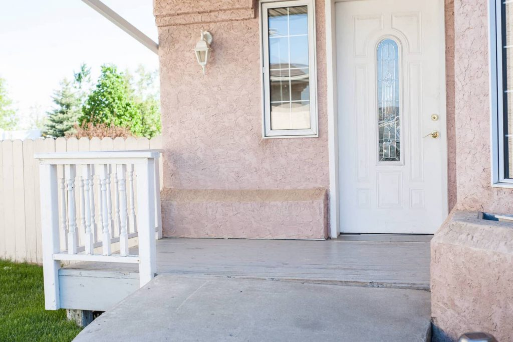 The levered door handle helps with ease of access, but the sunken concrete is an issue that may have been avoided by waiting a little longer for the ground to settle before pouring.