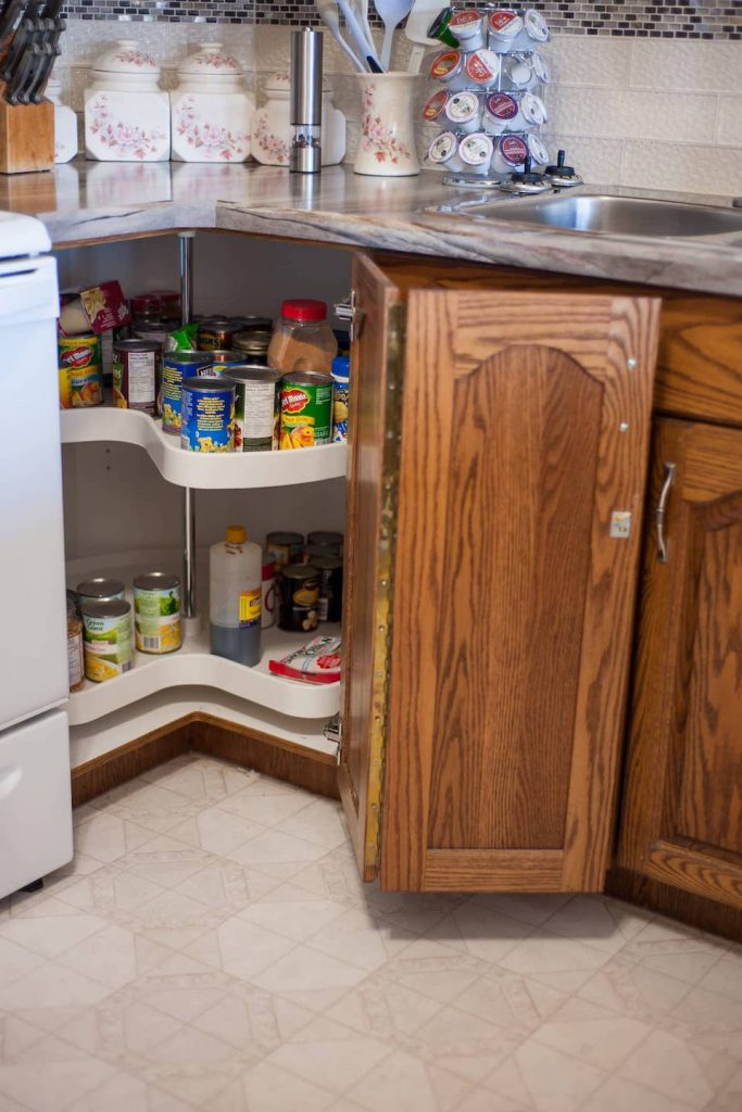 This corner cabinet Lazy Susan makes accessing items at the back of a deep cupboard much easier for everyone.