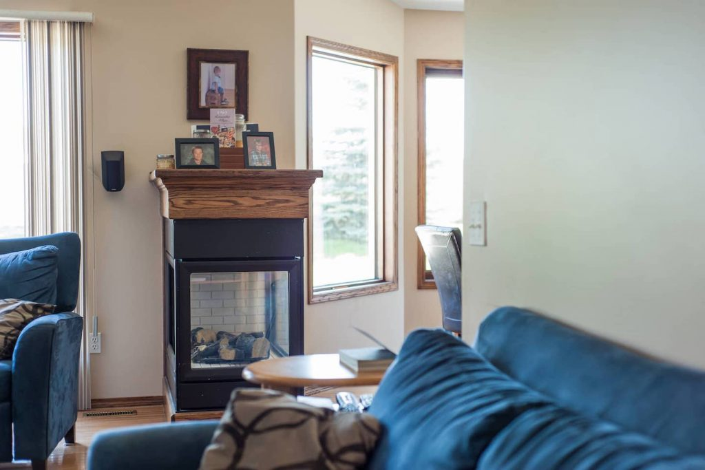 The 3 sided fireplace is a definite bonus in Saskatchewan! It is gas, and separates dining room and living room, and is easily turned on by the light switch located on the adjacent wall.