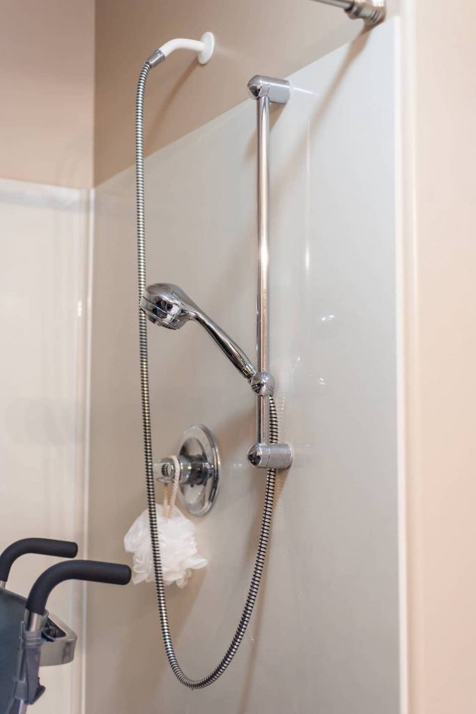 The shower head slides to different positions on the pole, making it accessible to any family member. The levered handle is great for people with limited dexterity in their hands.