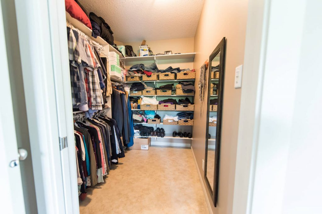 The wheel in closet has a shorter clothing bar for the homeowner who uses a wheelchair, as well as a higher one for a taller person. There is plenty of room for turning and maneuvering, and the pocket door is an added bonus!
