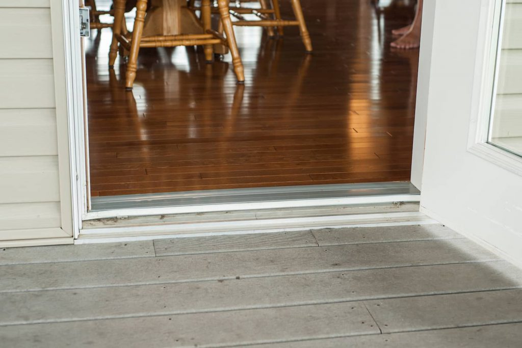 The door to the back deck hosts a fairly significant drop onto the deck, which is not a huge issue for the homeowner, but could pose an accessibilty problem for someone with less mobility.
