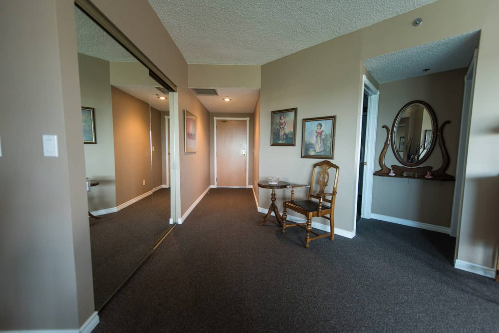 The hallway to the entrance door could prove difficult for someone with limited hand function to open, but it works well for the homeowner.