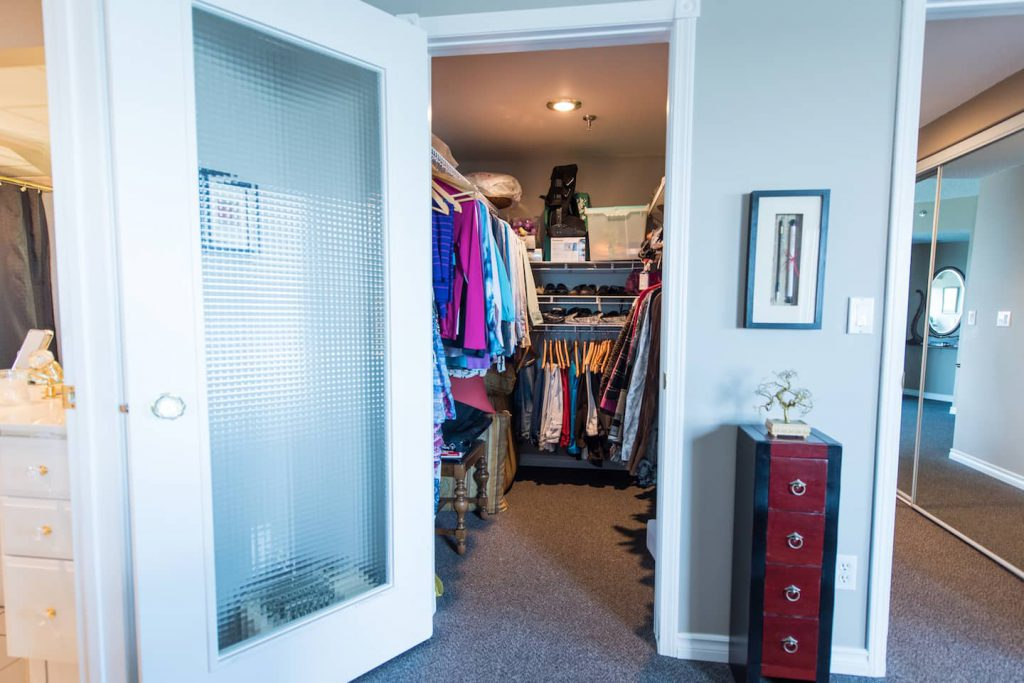 The roll in closet has a lot of storage space, and low rods make for easy accessibility of often used items.
