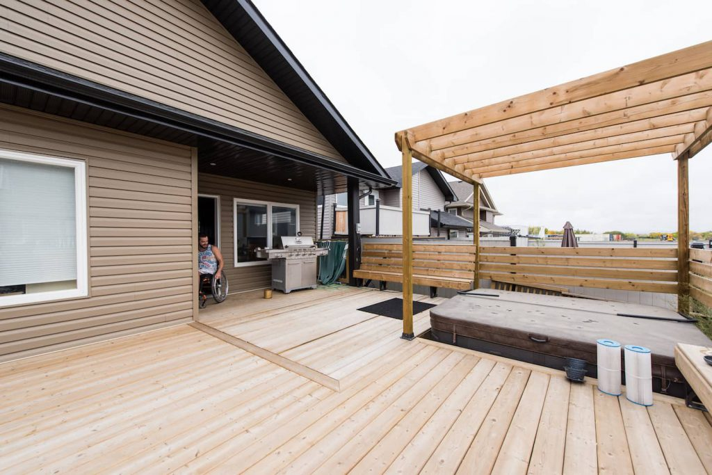 Large wooden deck off of back entrance