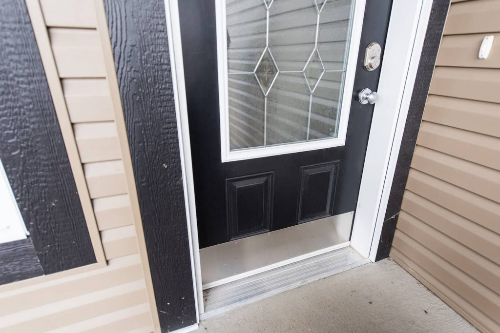 The front door entrance uses a commercial plate for easy access. This works well for the homeowner.