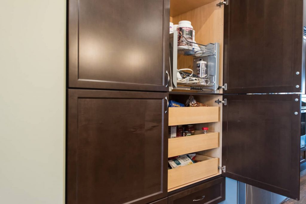 The kitchen pantry features pull out shelves on the bottom, and pull downs from the top.