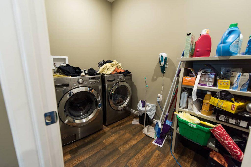 The front load washing machine and dryer set directly on the floor work well for this homeowner.