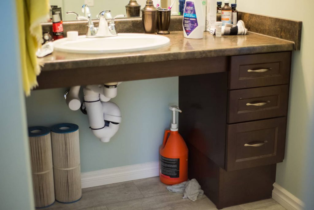 Wheel under sink with side drawers for accessible storage.