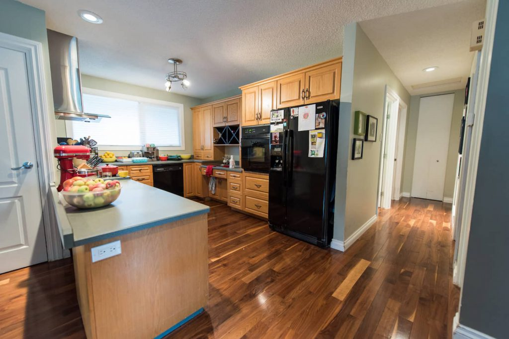 This kitchen works great for everyone in the home. The sink is slightly lower than the other counters for reaching purposes, and there is a lot of storage, both low and high.
