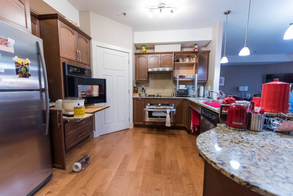 This accessible kitchen offers many pullouts for added accessibility. Pullout cutting boards give added workspace, as well as a place to set hot or heavy items. Pull out shelves on upper cupboards help to create added accessible storage.