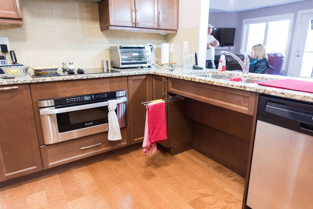 The cutout underneath the countertop stove is popular when creating access in the kitchen.