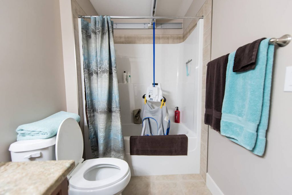 The main bathroom features a ceiling track lift which enables the homeowner safe transfers into the tub.