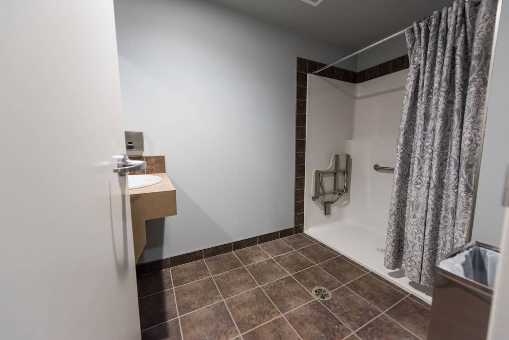 Accessible shower adjacent to gym.