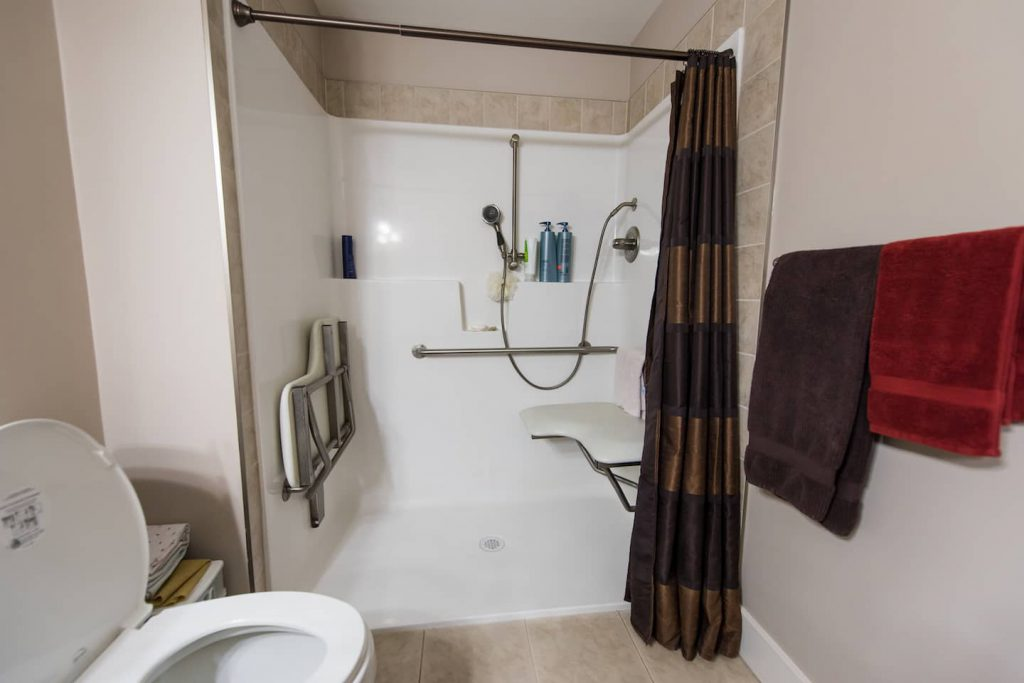 The Large Shower In Master Bathroom Has A Bench Attached Into It There
