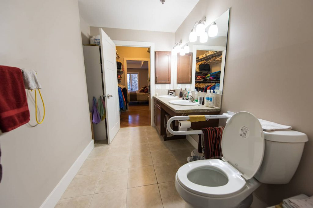 The grab bar helps to assist with safe transfers. Non slip tile lines the bathroom floor.