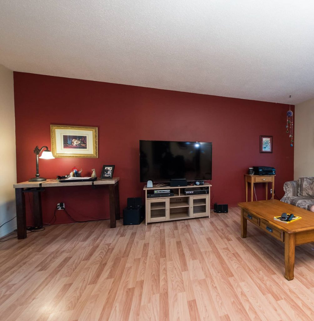 The spacious living room has been left open, and extra space allows for an accessible work are.