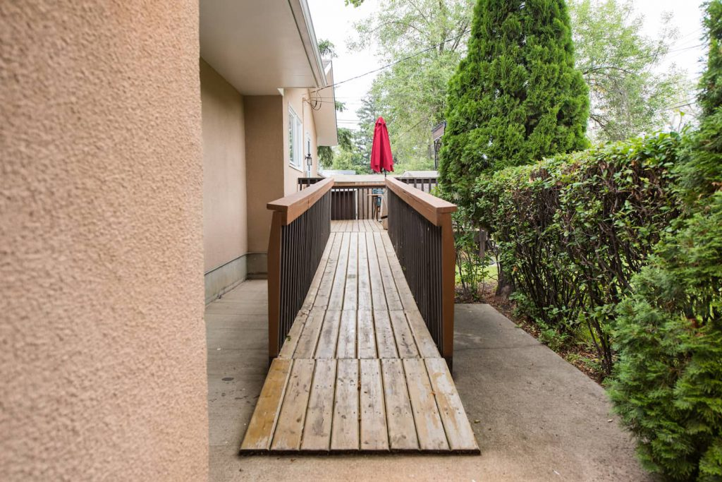 The ramp leads to the back patio from the concrete sidewalk. The lip at the end of the ramp is not an issue for the homeowner, who uses a power chair.