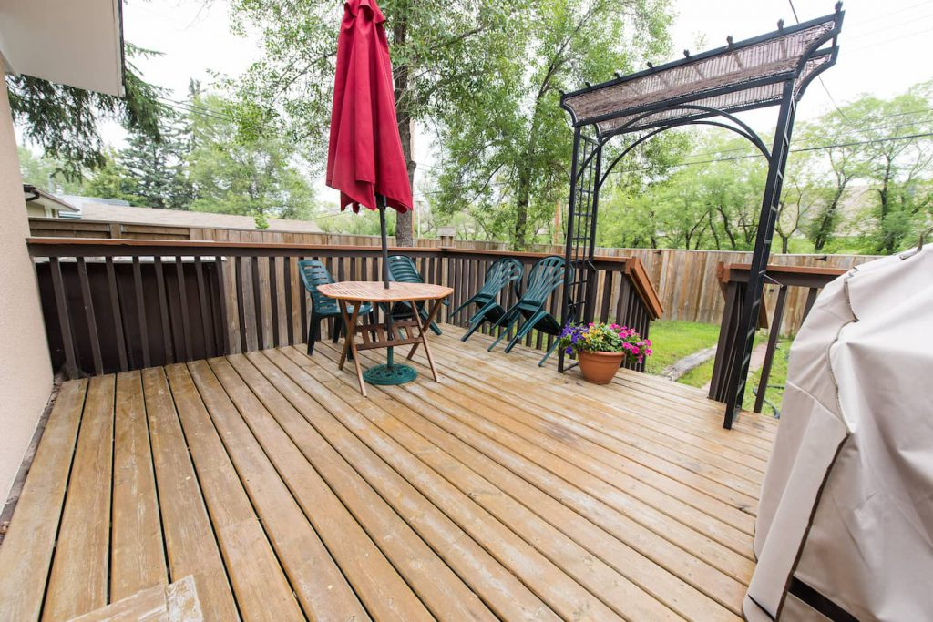 The wooden deck is accessible by either the side ramp, or from the house.